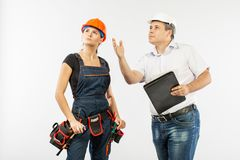 Contractors people discussing the plan of building over white background royalty free stock image