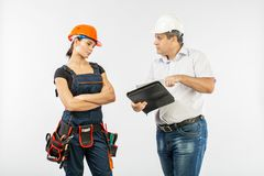 Contractors people discussing the plan of building over white background. Foreman with builder women wearing helmets royalty free stock image