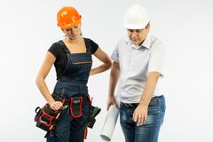Contractors people discussing the plan of building over white background. Foreman with builder women wearing helmets royalty free stock photography