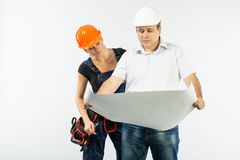Contractors people discussing the plan of building over white background. Foreman with builder women wearing helmets royalty free stock images