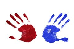 Contradiction. Marks of two hands (paint: red and blue) trying to get away from each other (thumbs on the opposite sides) - symbolizing contradiction, contrast Stock Photography