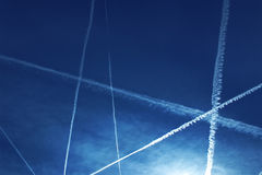 Contrail. In the dark blue sky, a beautiful show royalty free stock image