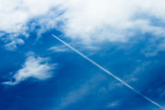 Contrail in The Blue Sky Royalty Free Stock Image