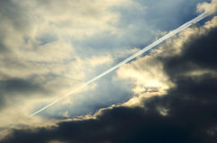 Contrail and clouds Royalty Free Stock Image