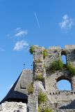 Contrail of the jet plane above Celje medieval castle in Slovenia Stock Photography