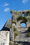 Contrail of the jet plane above ruin of Celje medieval castle in Slovenia. Contrail of the jet plane above majestic ruin of Celje medieval castle in Slovenia Royalty Free Stock Photography