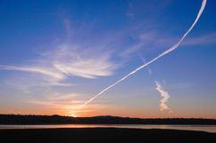 Contrail at sunrise Royalty Free Stock Image