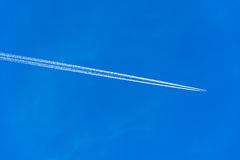 Contrails of airplane Stock Images