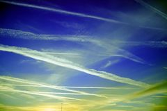 Contrails in the blue sky stock photo