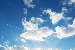 Contrails and clouds Stock Images