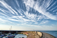 Contrails At Lyme Regis Harbour Stock Photography