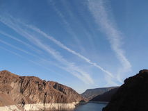 Contrails. Near Hoover Dam in Nevada Stock Images