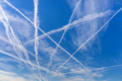 Contrails. Over blue sky Royalty Free Stock Photography