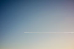 Chemtrail. Single chemtrail in a clear sky Stock Images