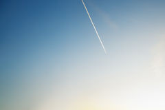 Contrails on Sunset Clear Sky. Jets Contrails on Clear Sky on Sunset stock photos