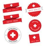 Contrassegni, distintivi ed autoadesivi fatti svizzero Illustrazione di Stock