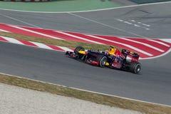 Contrassegni Webber (AUS) Red Bull che corre RB8 sulla pista Fotografia Stock