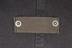 Contrassegno in bianco dei jeans Immagine Stock