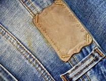 Contrassegno del Brown sulle blue jeans Immagine Stock Libera da Diritti