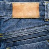Contrassegno di cuoio Grungy sui jeans Fotografia Stock