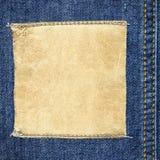 Contrassegno di cuoio quadrato sui jeans Fotografia Stock Libera da Diritti