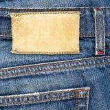 Contrassegno di cuoio sui jeans Fotografia Stock
