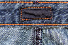 Contrassegno scuro sui jeans Immagine Stock