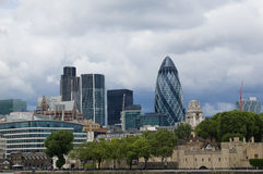 Contrast between ancient and modern in London. A view showinf the tower of London and skycrapers in the background Royalty Free Stock Photo