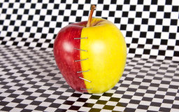Contrast apple with two diffirent halves Royalty Free Stock Image