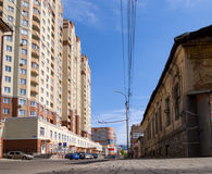 Contrast in architecture: the neighborhood of the old building and the new LCD `Heart of the City` on Kukolkin Street. Voronezh, Russia - May 01, 2017: Contrast Stock Photos