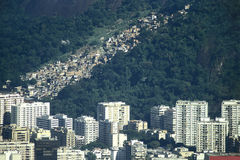 Contrast bewtween richness and poverty in Brazil: skyscrapers an. The tall buildings on the Botafogo district of Rio de Janeiro (Brazil) and a typical favela ( Royalty Free Stock Photography