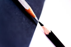Contrast: black white pencils facing. Conceptual shot depicting contrast through black and white pencils facing each other Royalty Free Stock Photography