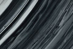 Contrast in black and white. A black and white contrast rich mixed oil paint royalty free stock photo