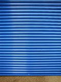 Contrast Blue Closed Shutter Door Royalty Free Stock Photography