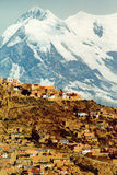 La Paz city. Scenic view of La Paz city with snow covered mountains in background, Bolivia Royalty Free Stock Photo