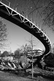 Contrast In A Bridge. Classic black and white contrast curves across the scenescape as this unique architecture curves over the waterfall below. Taken in Stock Photo
