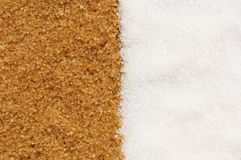Contrast (brown and white sugar). Two kinds of sugar: brown and white Stock Image