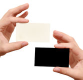 Contrast business cards in hand. Two business cards in hand. white and black Royalty Free Stock Photos