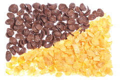 The contrast of the chocolate and corn flakes. Royalty Free Stock Photo