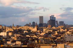 Contrast in the city. The skyline of Madrid (Spain) from de CBA (Circulo de Bellas Artes) during the sunset Royalty Free Stock Images
