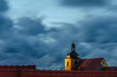 Contrast between the sky and the yellow light querfurt. Contrast of color between the sky and the yellow light querfurt royalty free stock image