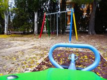 A different perspective of the swings royalty free stock image