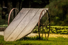 Contrast colors of a wagon next to a lake Stock Photos