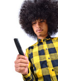 Contrast concept. Young man with long hair make question form Comb as contrast concept Stock Photography