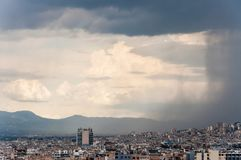 Contrast dark wall of falling water from the moody sky of the coming storm on the city. Panoramic cityscape view on Greece capital. Athens, Greece - June 12 royalty free stock photos