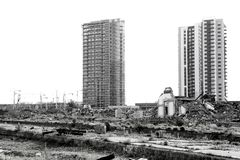 Contrast of demolished old house and contruction site with new skyscrapers. Belgrade, Serbia - May 7, 2019 : Contrast of demolished old house and construction stock image