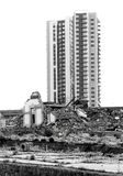 Contrast of demolished old house and contruction site with new skyscrapers. Belgrade, Serbia - May 7, 2019 : Contrast of demolished old house and contruction royalty free stock photography