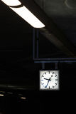 Contrast Diagonal Flourescent Lights Leading to Square Geometric. Clock Time Architecture Stock Photos