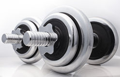 Contrast dumbbells. Dumbbell close up on a white background Stock Photo