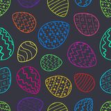Contrast Easter pattern with color outline eggs. Bright contrast Easter seamless pattern with color outline cartoon decorated eggs on dark background. Ornate Royalty Free Stock Images